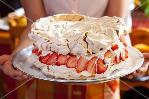 Pavlova with creamy lemon filling and strawberries