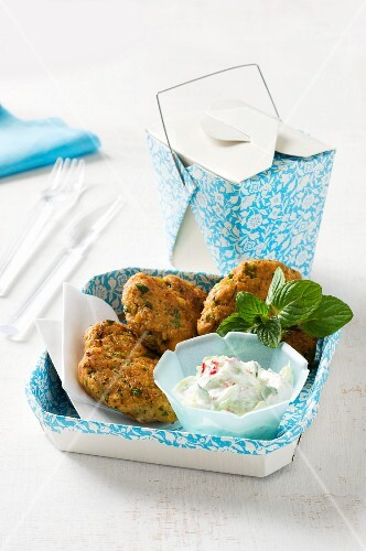 Fritters with chickpeas and sausage served with cucumber yoghurt