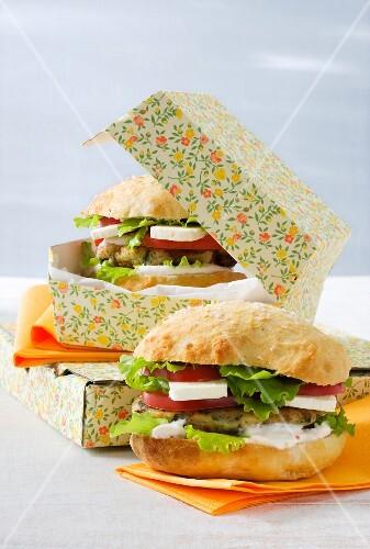 Vegetarian aubergine burger with feta, lettuce and tomatoes