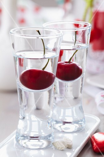 Cherry schnapps in shot glasses with cherries