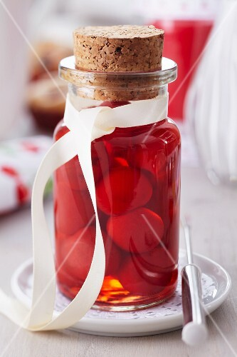 A jar of preserved sweet cherries