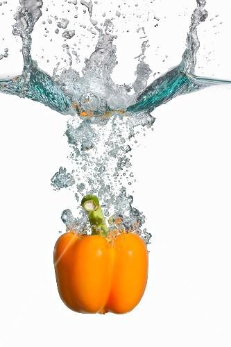 Yellow Bell Pepper Splashing in Water