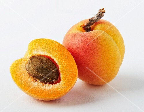 One half and one whole apricot