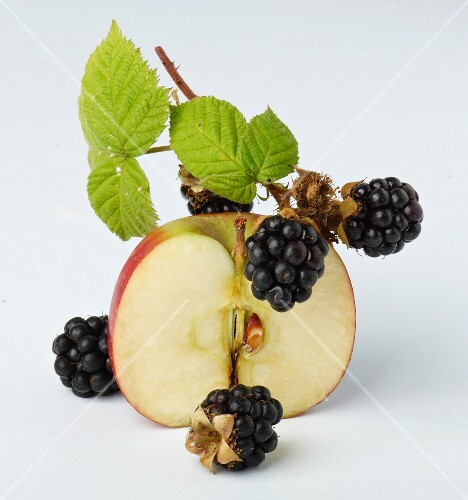 Small blackberries and half an apple