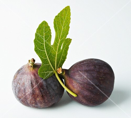 Two figs with a fig leaf