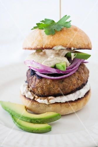 Hamburger with Avocado, Red Onion and Horseradish Sour Cream Sauce