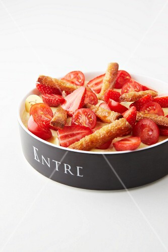 Tomatoes and strawberries with olive oil