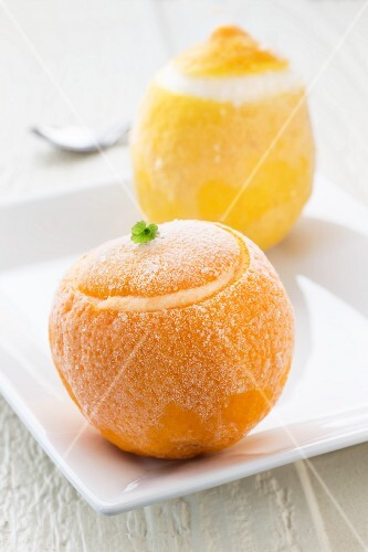 A frozen orange and a frozen lemon