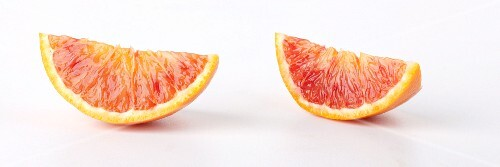 Two blood orange wedges