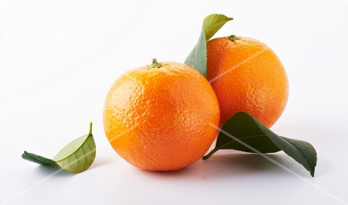 Two Whole Oranges; One with Leaf