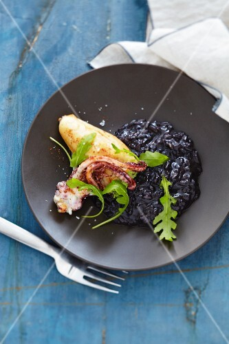 Stuffed squid on a bed of black risotto