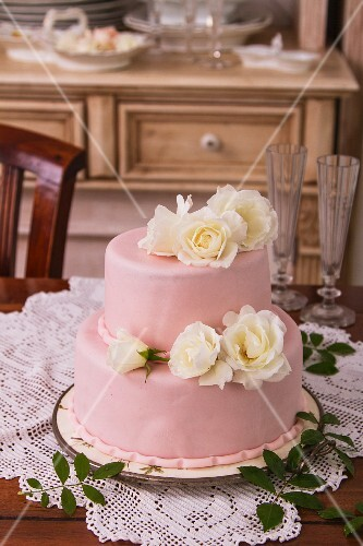 A wedding cake with white roses