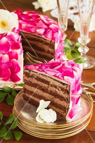Celebratory layer cake with rose petals