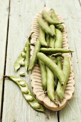Broad beans in a wooden bowl