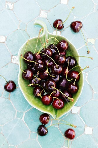 Cherries in a leaf-shaped bowl