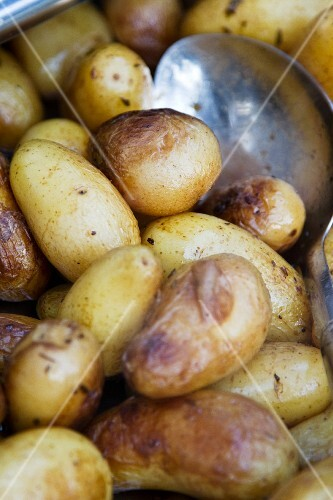 Potatoes boiled in their skins, with a spoon (close-up)