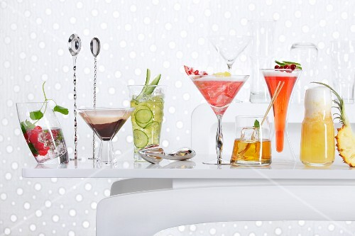 Lots of different cocktails on a bar table