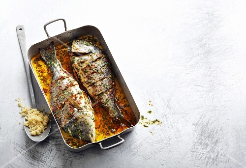 Gilt-head bream baked in spiced oil