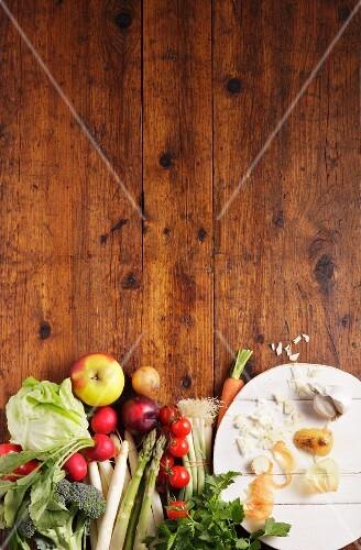 Vegetables and fruit on a wooden slab