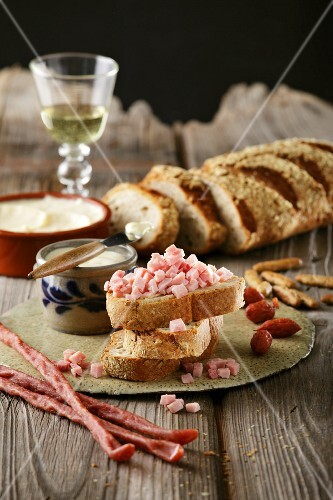 A snack of bread with diced sausage and lard