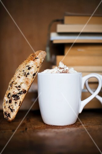 Hot chocolate with biscotti and books