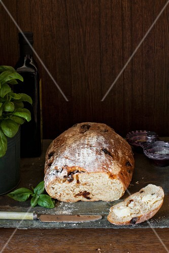 Sun dried tomato and basil bread with a buttered slice
