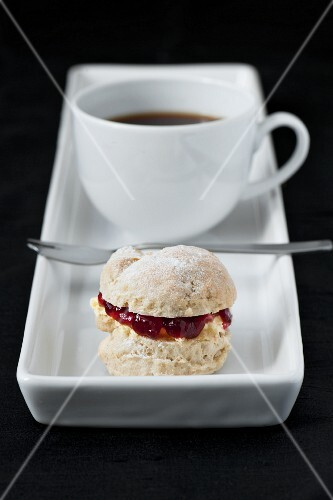 cup of coffee with small scone