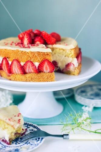 Strawberry Fraisier cake slice removed