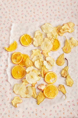 Fruit crisps laid out to dry on grease-proof paper