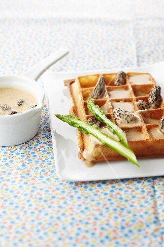 Savoury waffle with green asparagus and a morel sauce