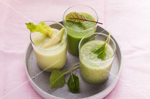 Three green smoothies, fresh and healthy (celery and avocado, herb, and kiwi and spinach)