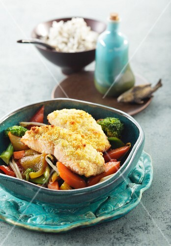Wild salmon fillet with a wasabi & ginger crust on wild rice and Asian-style vegetables