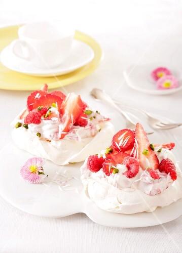 Mini pavlova with rose cream, strawberries and raspberries