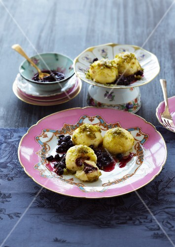 Semolina dumplings with coffee and nougat filling, blueberry compote and pistachio & breadcrumb butter