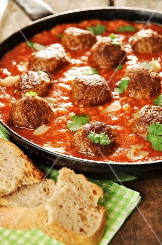 Falafels in tomato and paprika sauce with almonds and coriander