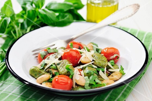 Basil gnocchi with white beans, tomatoes and balsamic vinegar