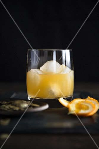 A whisky cocktail with orange