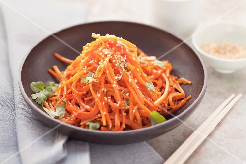 Fried grated carrot with sesame seeds and coriander (Asia)