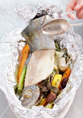 Trout with vegetables, wrapped in foil