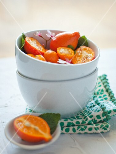 Tangelos and Oranges in a White Bowl