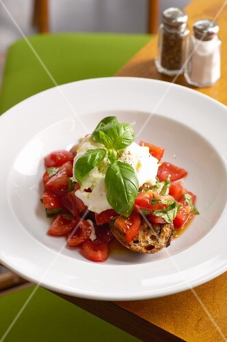 Bruschetta with vine tomatoes, mozzarella and basil