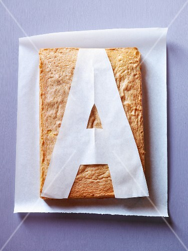A cake with a template of the letter A