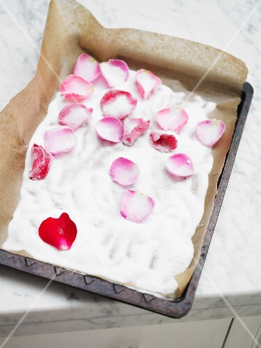 Crystallised rose petals on a baking tray