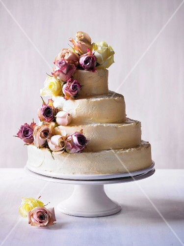 Four-tier wedding cake with rose decoration