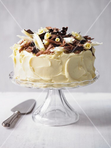 A birthday cake decorated with chocolate curls