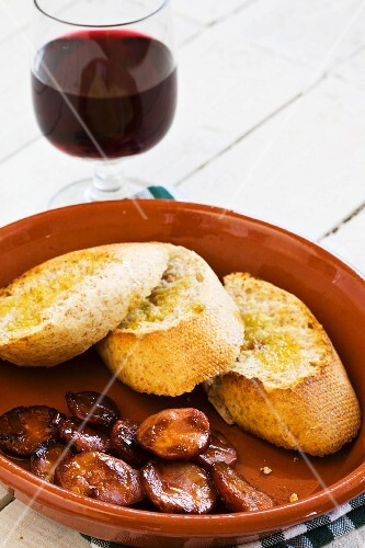 Pinchos with chorizo, served with red wine (Spain)