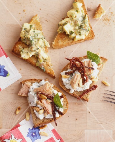 Slices of bread topped with egg salad and with herby cream cheese