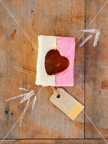 A heart cut out of two colourful marshmallows