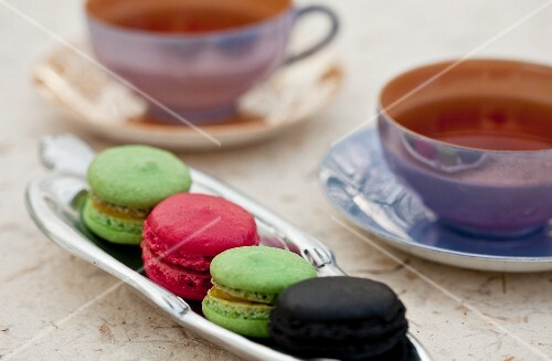 Colourful macaroons on a serving platter for afternoon tea