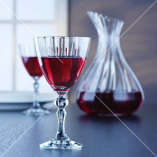 A carafe and glasses of red wine